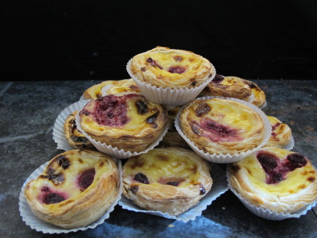 Pasteis De Nata with raspberries